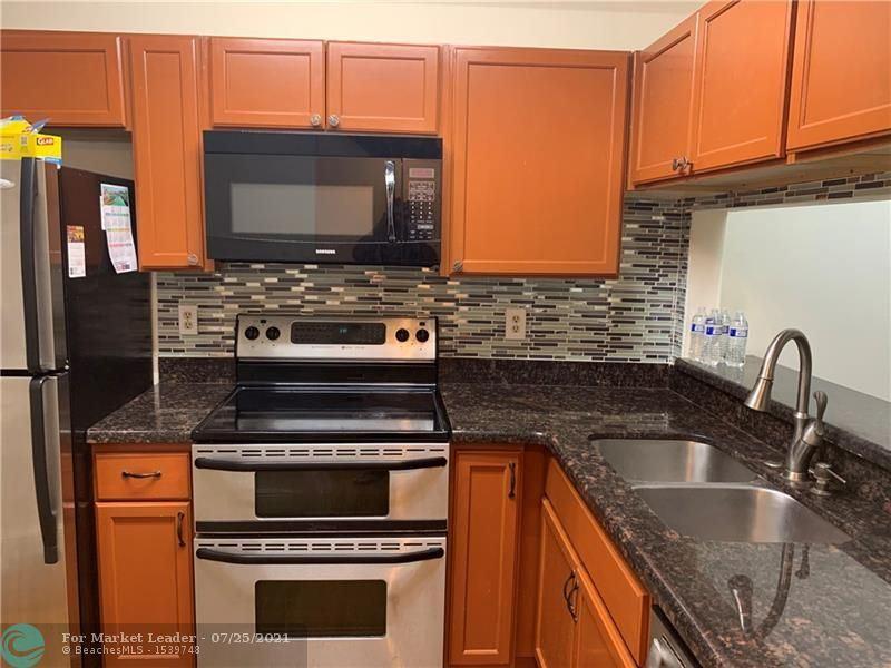 Photo of 8311 Royal Palm Blvd #202, Coral Springs, FL 33065 (MLS # F10294276)