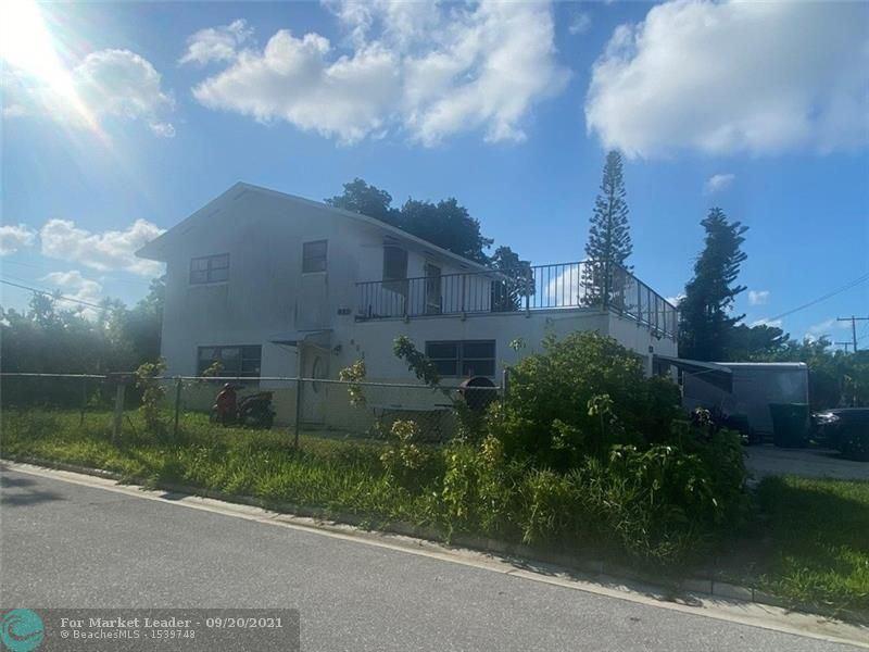 Photo of 981 W 37th St, Riviera Beach, FL 33404 (MLS # F10301281)