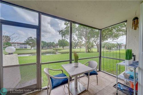 Photo of 700 S Hollybrook Dr #107, Pembroke Pines, FL 33025 (MLS # F10258288)