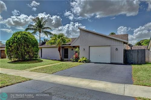 Photo of 10142 NW 21st St, Pembroke Pines, FL 33026 (MLS # F10284291)