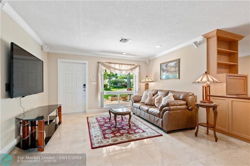 Photo of 2115 NE 54th Ct, Fort Lauderdale, FL 33308 (MLS # F10300294)