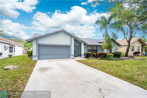 Photo of 5022 NW 45th Ave, Coconut Creek, FL 33073 (MLS # F10221307)