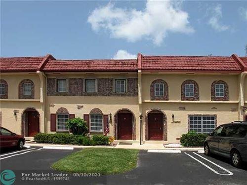 Photo of 3064 Riverside Dr #G5, Coral Springs, FL 33065 (MLS # F10283310)