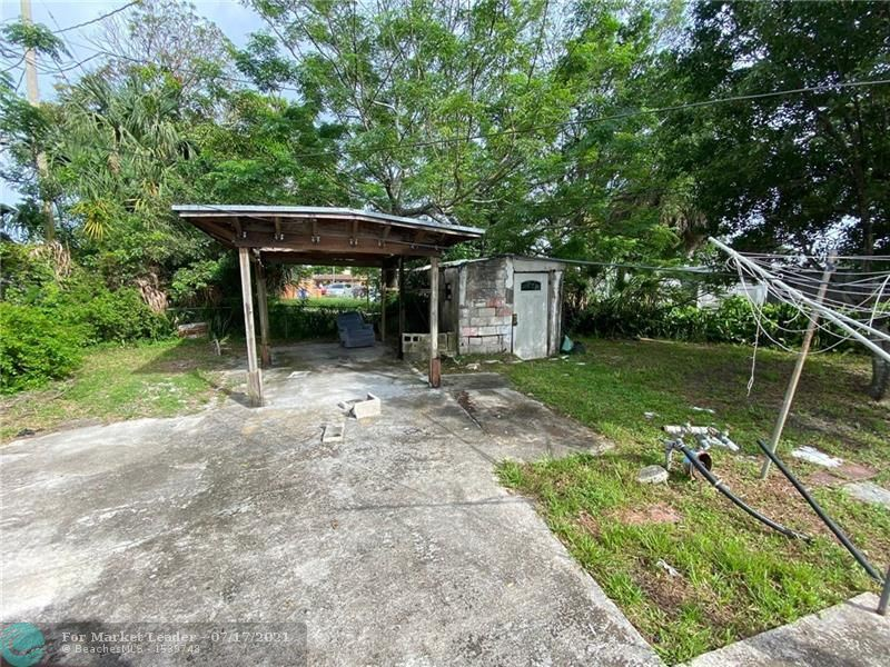 Photo of 1720 NW 25th Ave, Fort Lauderdale, FL 33311 (MLS # F10293315)