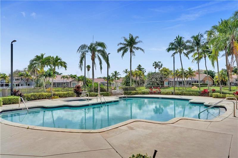 Photo of 1179 Laguna Springs Dr, Weston, FL 33326 (MLS # F10272317)
