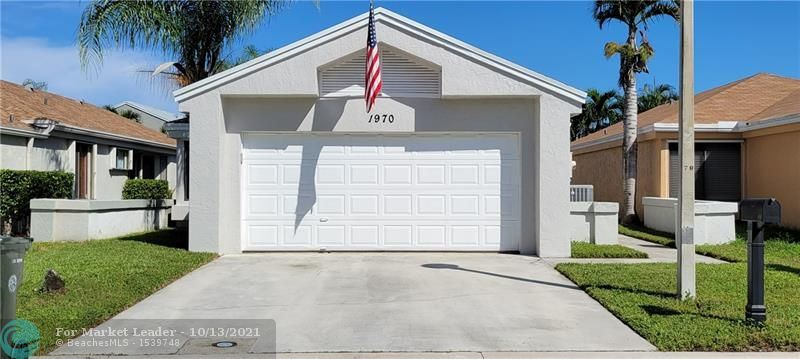 Photo of 1970 NW 39th Ave, Coconut Creek, FL 33066 (MLS # F10304328)