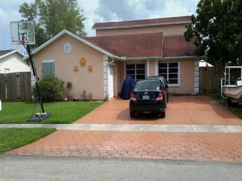 Photo of 8420 NW 7th St, Pembroke Pines, FL 33024 (MLS # F10272329)