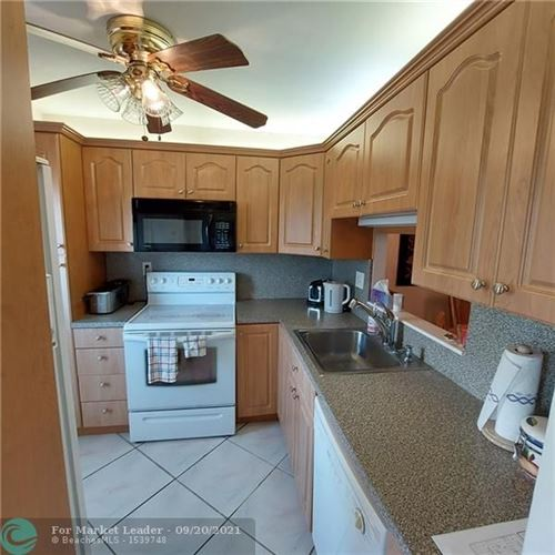Photo of 4806 NW 36th St #O-414, Lauderdale Lakes, FL 33319 (MLS # F10301338)