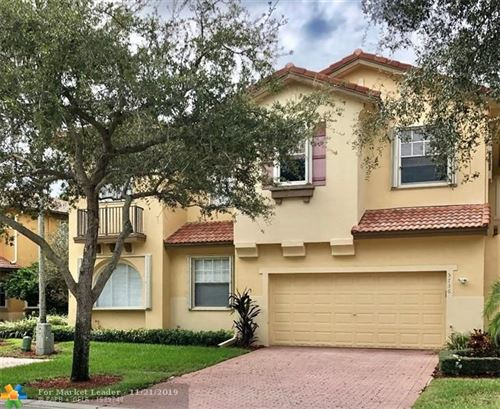 Photo of 5736 NW 120th Ave, Coral Springs, FL 33076 (MLS # F10204341)