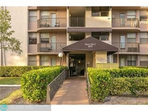 Photo of 2771 Riverside Dr #103-A, Coral Springs, FL 33065 (MLS # F10229343)