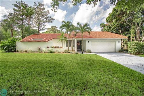 Photo of 9222 Shadow Wood Blvd, Coral Springs, FL 33071 (MLS # F10300343)