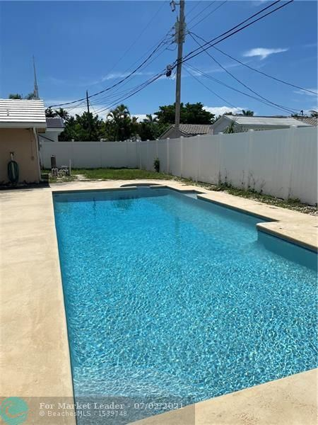 Photo of 2130 NE 55th Ct, Fort Lauderdale, FL 33308 (MLS # F10291344)