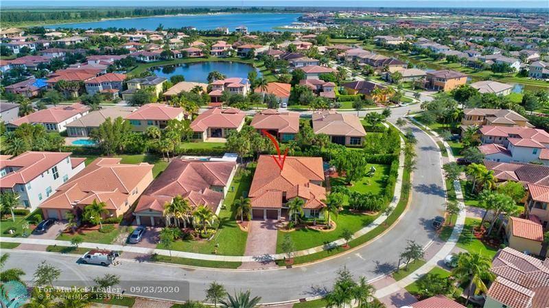 Photo of 12319 NW 80th Pl, Parkland, FL 33076 (MLS # F10250346)
