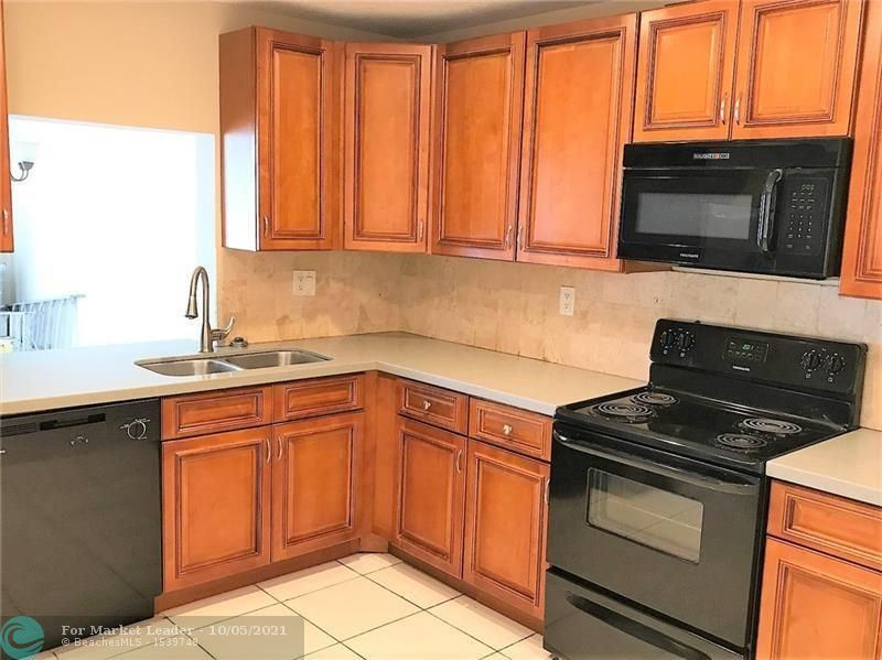 Photo of 1157 HAMPTON BLVD #1157, North Lauderdale, FL 33068 (MLS # F10303351)