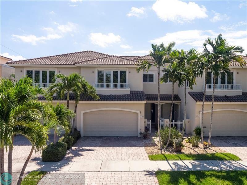 Photo of 1306 NE 26th Ave, Fort Lauderdale, FL 33304 (MLS # F10233356)