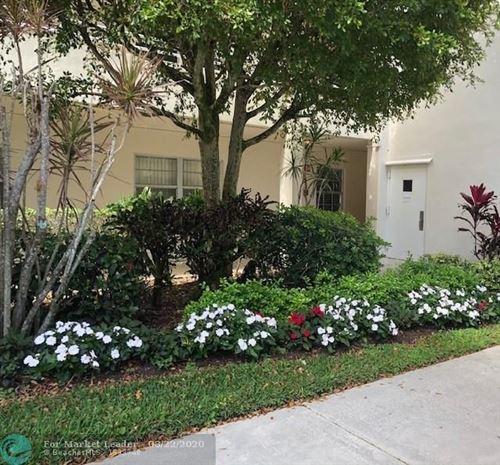 Photo of 535 Oaks Dr #101, Pompano Beach, FL 33069 (MLS # F10192358)