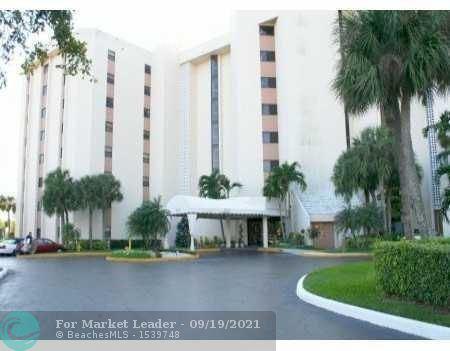 Photo of 7400 Radice Ct #604, Lauderhill, FL 33319 (MLS # F10301360)
