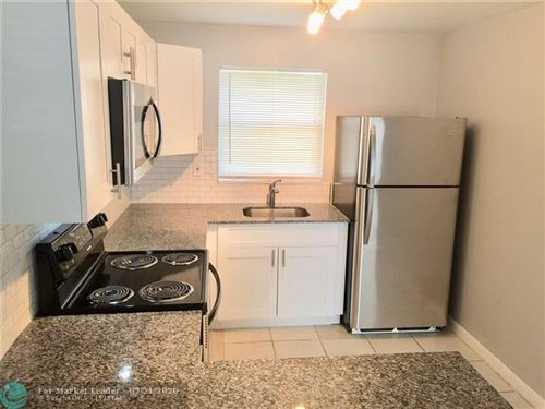 Photo of 1440 NW 22nd St #3, Fort Lauderdale, FL 33311 (MLS # F10217362)