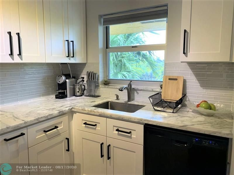 Photo of 1750 NW 3rd Ter #303-C, Fort Lauderdale, FL 33311 (MLS # F10232362)