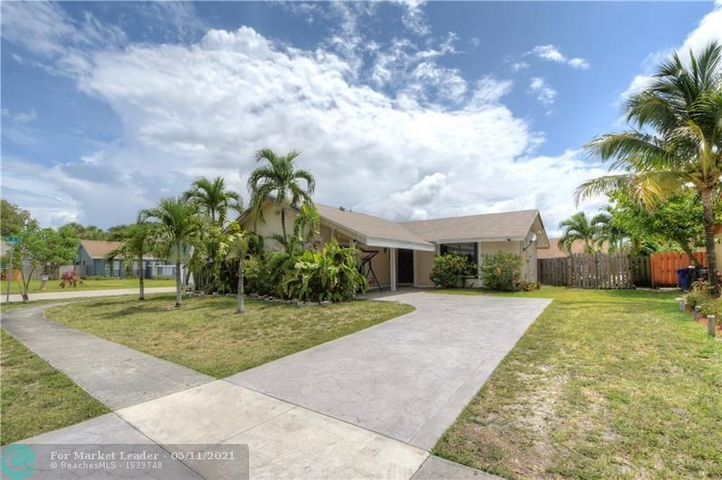 Photo of 400 SW 75th Way, North Lauderdale, FL 33068 (MLS # F10283365)
