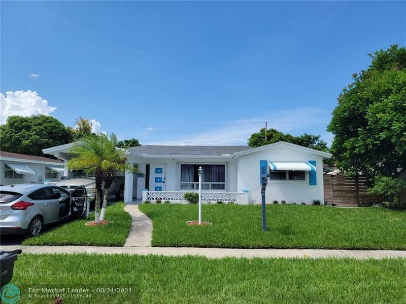 Photo of 3441 NW 33rd Ct, Lauderdale Lakes, FL 33309 (MLS # F10291366)