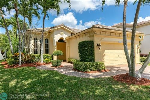 Photo of 12431 NW 57th St, Coral Springs, FL 33076 (MLS # F10223374)