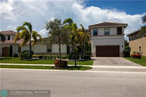 Photo of 11875 NW 81st Ct, Parkland, FL 33076 (MLS # F10244375)