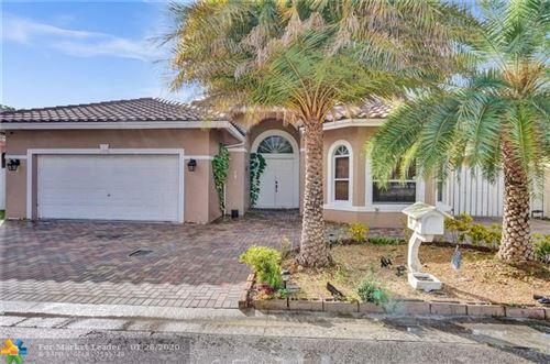 Photo of 11570 SW 10th St, Pembroke Pines, FL 33025 (MLS # F10213377)