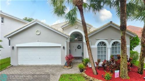 Photo of 2101 NW 49th Ave, Coconut Creek, FL 33063 (MLS # F10301378)