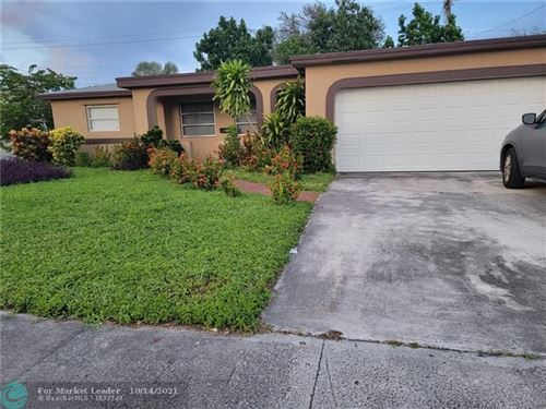 Photo of 3131 NW 43rd St, Lauderdale Lakes, FL 33309 (MLS # F10304385)
