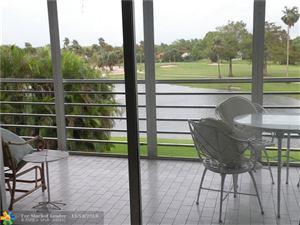 Photo of 3980 Oaks Clubhouse Dr #306, Pompano Beach, FL 33069 (MLS # F10148387)
