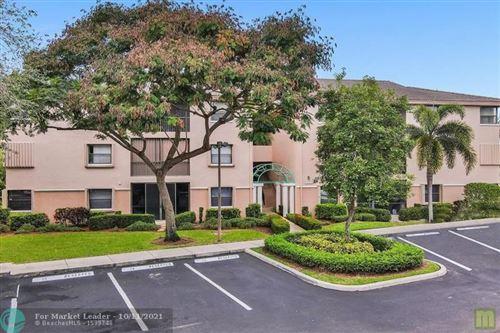 Photo of 4101 Coral Tree Cir #318, Coconut Creek, FL 33073 (MLS # F10303389)