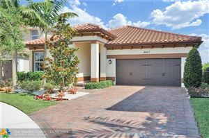 Photo of 9847 Blue Isle Bay, Parkland, FL 33076 (MLS # F10175391)