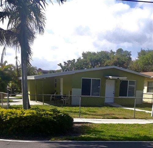 Photo of 422 Phippen Waiters Rd, Dania Beach, FL 33004 (MLS # F10273392)