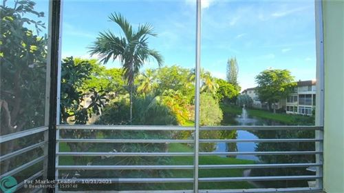 Photo of 5121 W Oakland Park Blvd #207, Lauderdale Lakes, FL 33313 (MLS # F10305392)