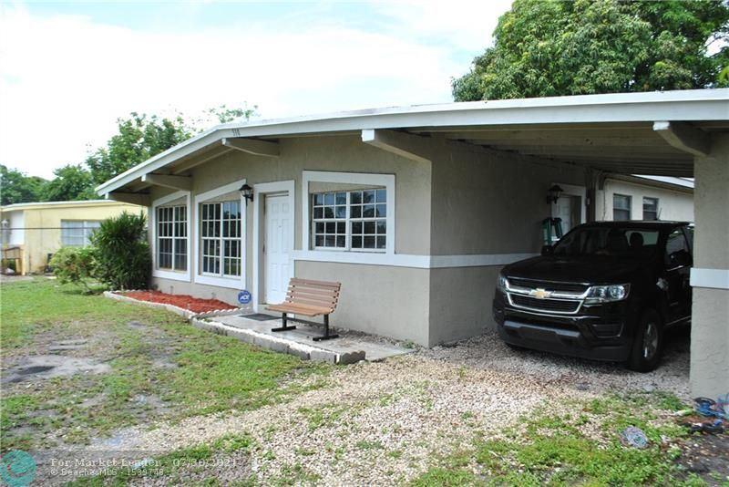 Photo of 310 NW 33rd Ave, Lauderhill, FL 33311 (MLS # F10294392)
