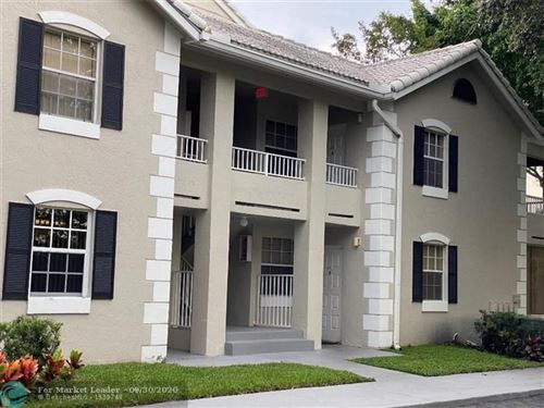 Photo of 2803 N Oakland Forest Dr #107, Oakland Park, FL 33309 (MLS # F10251393)