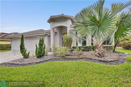Photo of 6531 NW 98th Dr, Parkland, FL 33076 (MLS # F10258394)