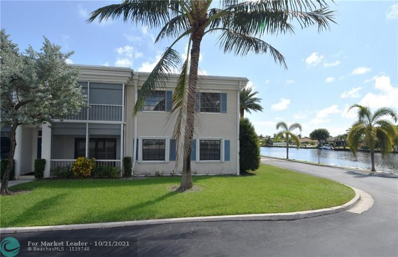 Photo of 110 Cypress Club Dr #101, Pompano Beach, FL 33060 (MLS # F10305397)