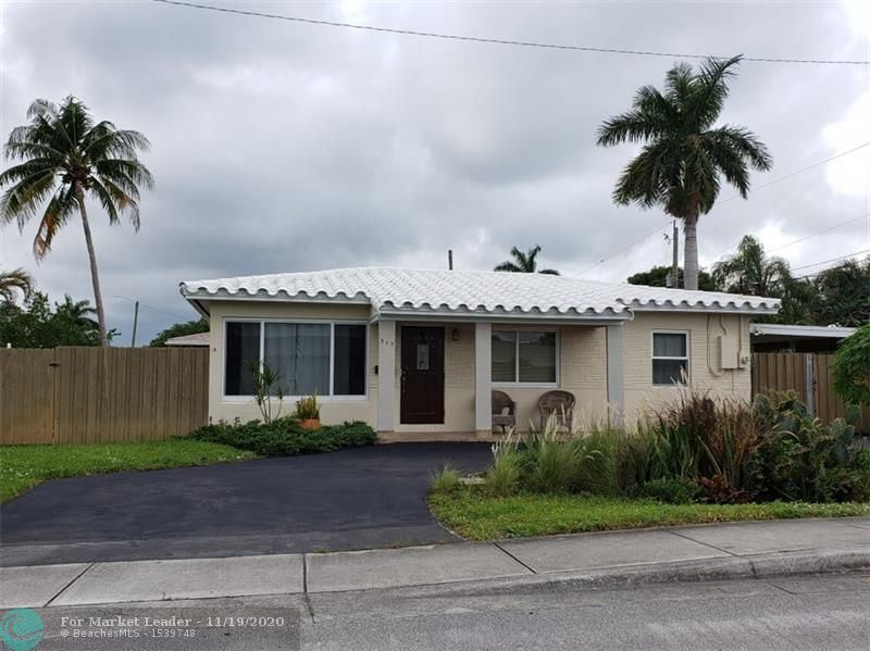 Photo of 317 NW 45th Ct, Oakland Park, FL 33309 (MLS # F10259400)