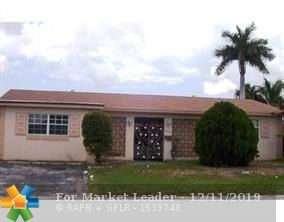 Photo of 2470 NW 63rd Ave, Sunrise, FL 33313 (MLS # H10766401)