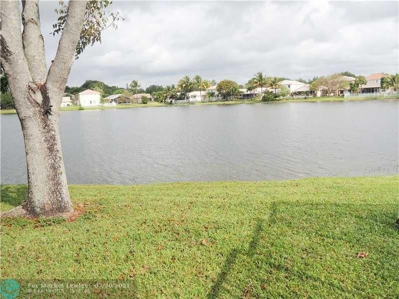 Photo of 3879 NW 62nd Ct, Coconut Creek, FL 33073 (MLS # F10293402)
