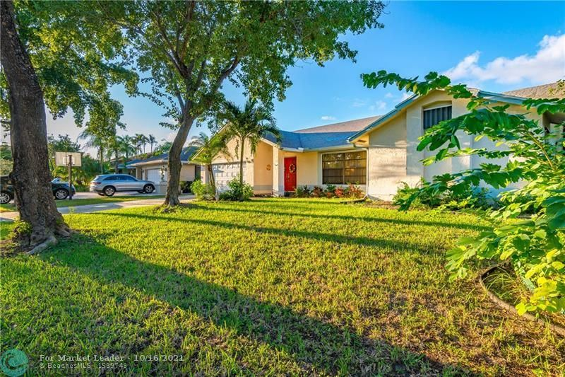Photo of 4825 NW 50th St, Coconut Creek, FL 33073 (MLS # F10304403)