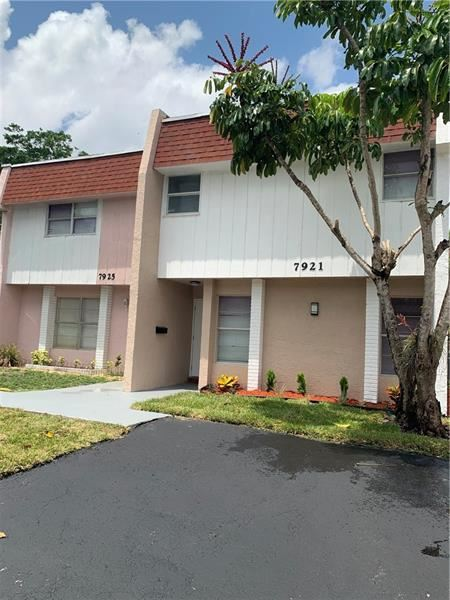 Photo of 7921 Kimberly Blvd #7921, North Lauderdale, FL 33068 (MLS # F10281409)