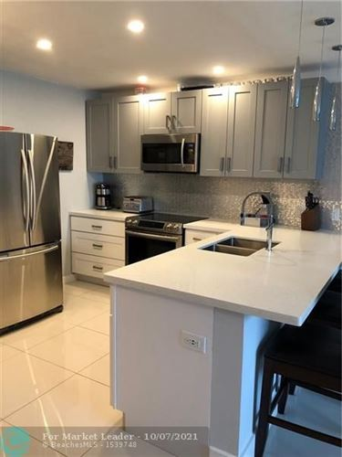 Photo of 2701 Middle River Drive #3, Fort Lauderdale, FL 33306 (MLS # F10303411)