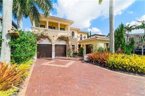 Photo of 9401 Eden Mnr, Parkland, FL 33076 (MLS # F10271415)