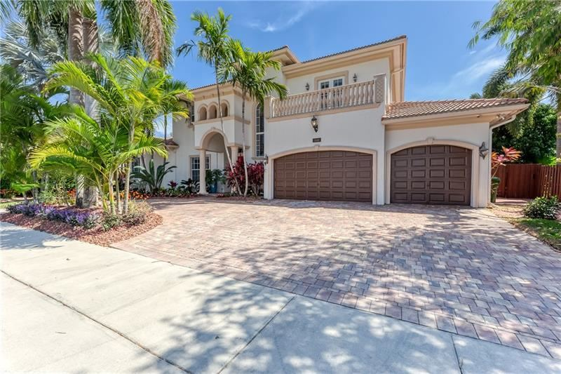 Photo of 1008 N Mandarin Isle, Fort Lauderdale, FL 33315 (MLS # F10273415)