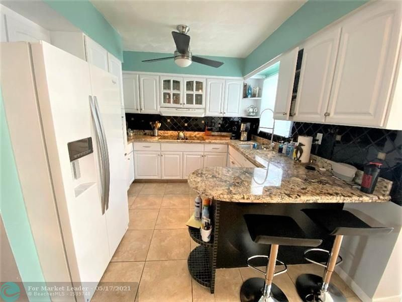 Photo of 340 NW 37th St, Oakland Park, FL 33309 (MLS # F10284415)