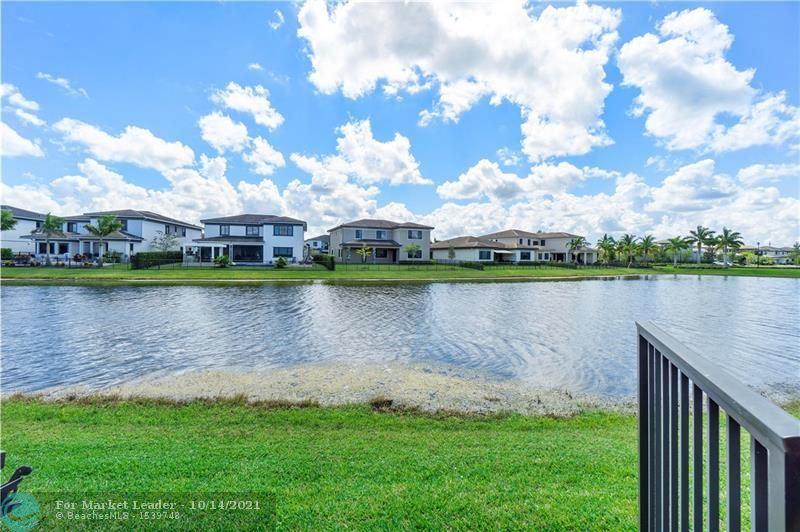 Photo of 10592 N Lago Vista Cir, Parkland, FL 33076 (MLS # F10304417)