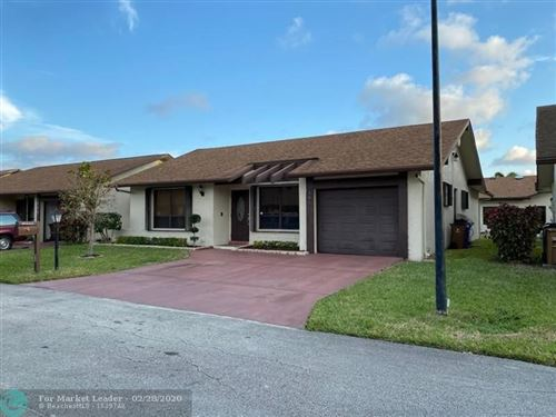 Photo of 1954 SW 15TH PL, Deerfield Beach, FL 33442 (MLS # F10218418)